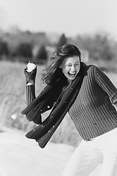 woman having a good time playing in the snow