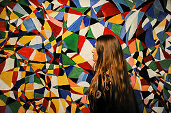 """© Licensed to London News Pictures. 21/04/2017. London, UK.  A staff member views """"Towards a Sky"""", 1953, by Fahrelnissa Zeid (Est. GBP 550-650k), at a preview at Sotheby's, New Bond Street, of upcoming sales of Arts of the Islamic World, 20th century Middle East Art and Orientalist art. Photo credit : Stephen Chung/LNP"""