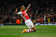 Alexis Sanchez of Arsenal (right) celebrates scoring the opening goal against Southampton during the Capital One Cup match at the Emirates Stadium, London<br /> Picture by David Horn/Focus Images Ltd +44 7545 970036<br /> 23/09/2014