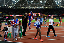 Great Britain's Mo Farah celebrates winning the men's 10,000 metre final with his children Amani, Aisha, Rhianna and Hussein Mo during day one of the 2017 IAAF World Championships at the London Stadium.