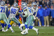 Jan 12, 2019; Los Angeles, CA, USA;  Dallas Cowboys quarterback Dak Prescott (4) hands off the ball to running back Ezekiel Elliott (21) against the Los Angeles Rams during an NFL divisional playoff game at the Los Angeles Coliseum. The Rams beat the Cowboys 30-22. (Kim Hukari/Image of Sport)