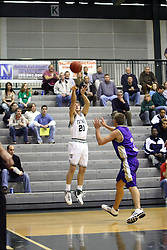 30 December 2006: Jordan Morris takes a 3 point shot before Zak Silas can stop him. The Titans outscored the Britons by a score of 94-80. The Britons of Albion College visited the Illinois Wesleyan Titans at the Shirk Center in Bloomington Illinois.<br />