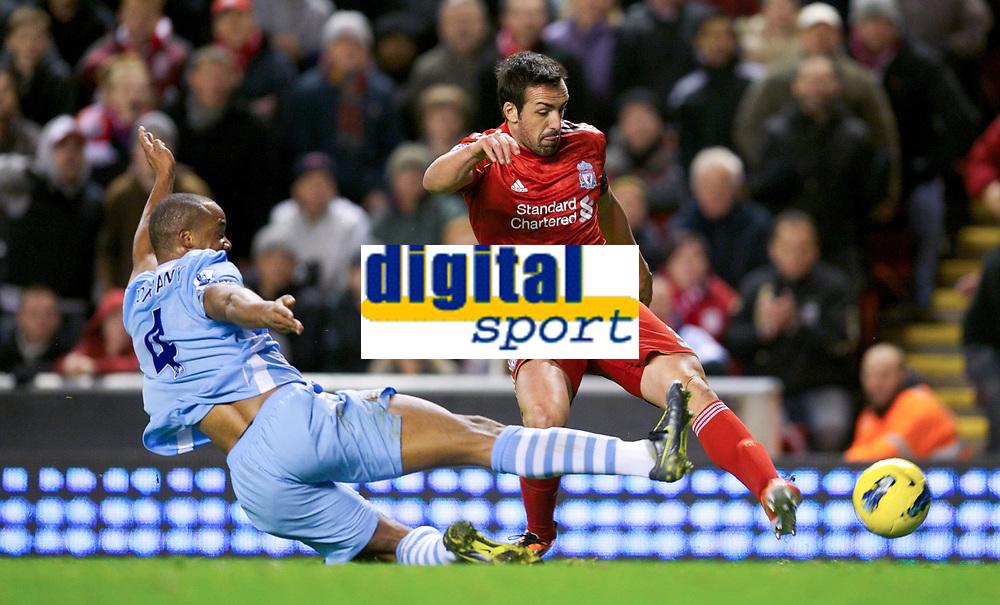 20111127: LIVERPOOL, ENGLAND - <br /> FC Liverpool vs Manchester City: English Premier League 2011/2012.<br /> In photo:  Jose Enrique in action against Manchester City's Vincent Kompany.<br />  PHOTO: CITYFILES