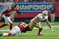 20 January 2013: Wide receiver (15) Michael Crabtree of the San Francisco 49ers catches a pass and is tackled by (23) Dunta Robinson of the Atlanta Falcons during the first half of the 49ers 28-24 victory over the Falcons in the NFC Championship Game at the Georgia Dome in Atlanta, GA.