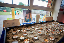 © Licensed to London News Pictures. 25/05/2015. DIDCOT, UK. Candles lit by classmates of 6 year old Derrin Jordon inside All Saints Primary School, where she attended. Police found three bodies, including her's, in Vicarage Road, Didcot, on Saturday evening and continue to search for Jed Allen in connection with the deaths. Photo credit : Cliff Hide/LNP