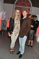 TAMZIN MERCHANT and FREDDIE FOX at a party hosted by Ines de la Frassange and Bruno Frisoni for Roger Vivier to launch the Roger Vivier book held at The Saatchi Gallery, London on 24th April 2013.
