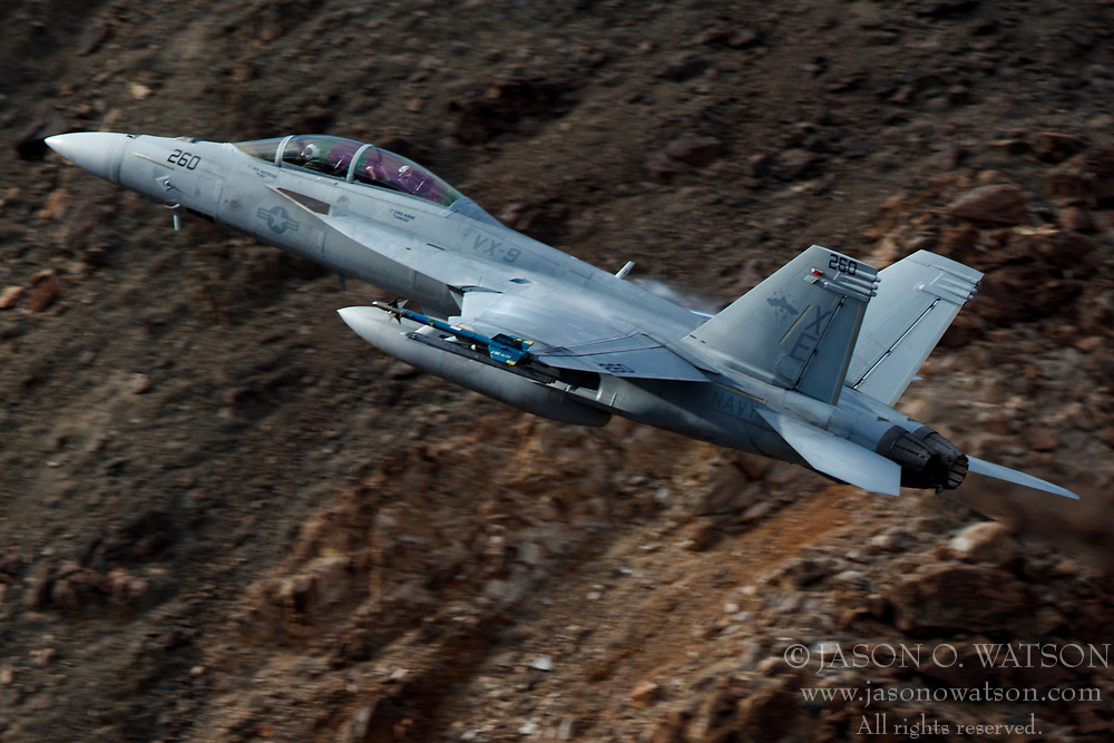Boeing F/A-18F Super Hornet (XE-260) from the United States Navy VX-9 Vampires squadron, Naval Air Weapons Station China Lake, flies low level through the Jedi Transition, Star Wars Canyon, Death Valley National Park, California, United States of America