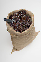 Sack of coffee beans with spoon