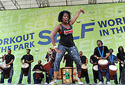 A CRUNCH instructor leads the Tabura class at SELF magazine's 21st annual Workout in the Park, Saturday, May 10, 2014, in New York's Central Park. (Photo by Diane Bondareff/Invision for SELF/AP Images)