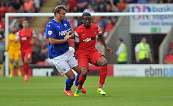 Leyton Orient's Kevin Lisbie tussles for the ball with Chesterfield's Ian Evatt - photo mandatory by-line David Purday JMP- Tel: Mobile 07966 386802 09/08/14 - Leyton Orient v Chesterfield - SPORT - FOOTBALL - Sky Bet Leauge 1 - London -  Matchroom Stadium