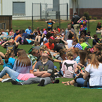 Mooreville Middle School students watch the Solar Eclipse on Monday afternoon from the baseball.