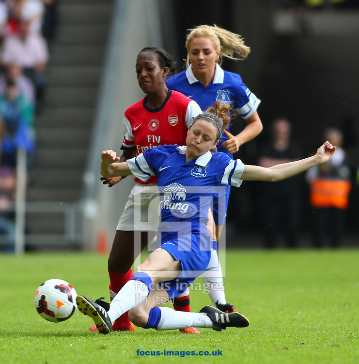 Danielle Carter of Arsenal L.F.C. is tackled by Danielle Turner of Everton L.F.C. during the FA Women's Cup Final match at stadium:mk, Milton Keynes<br /> Picture by David Horn/Focus Images Ltd +44 7545 970036<br /> 01/06/2014