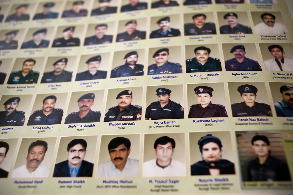 A poster of the Karachi Police force shows only a hand full of female police officers among a majority of male officers. <br /> Karachi, Pakistan, 2011