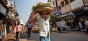 Man carrying bananas in Kolkata (India).