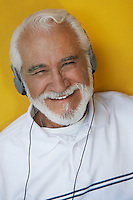Portrait of elderly man wearing headphones