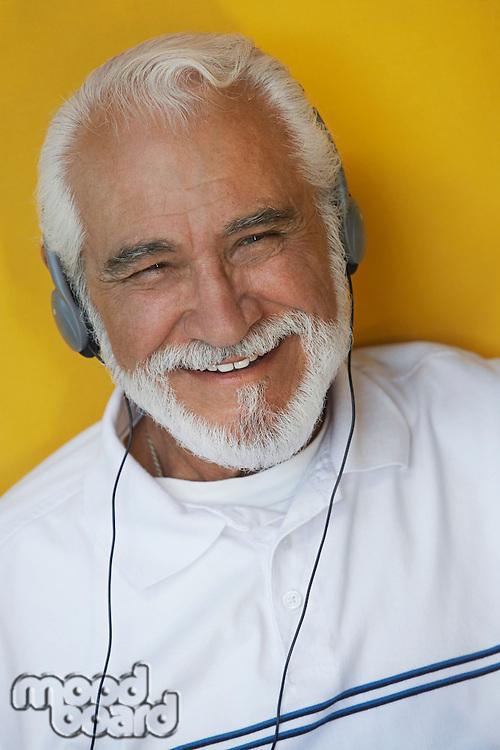 Portrait of elderly man wearing headphones