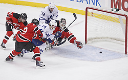 Jan 29, 2010; Newark, NJ, USA; Toronto Maple Leafs center Matt Stajan (14) scores a goal past New Jersey Devils goalie Martin Brodeur (30) during the third period at the Prudential Center. The Devils won 5-4 in overtime.