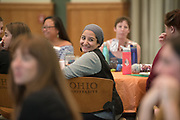 A student smiles as she listens to Gigi Secuban speak during the Women's Mentoring Meet and Greet event on Sept. 4, 2018 in Walter Rotunda. Photo by Hannah Ruhoff
