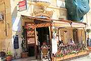 Small street cafe people sitting tables outside, Valletta, Malta