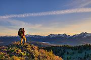 A backpacker ponders the Sawtooth Mountains, Idaho