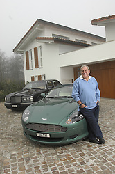 ZURICH,  SWITZERLAND - DEC-15-2006 - Hans-Peter Fassler at his water-front home near Zurich with his Bentley and Aston Martin DB9. (PHOTO © JOCK FISTICK)