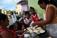 Kids get an early morning snack at a food stand in Leiva, a small remote village in the southern Colombian state of Nariño, on June 26, 2007. Leiva has long been a coca village; most of the people who live in the area have long relied on the coca business in order to make ends meet. But with increasing pressure by the Colombian government, with fumigation and manual eradication of the coca fields, many people are now trying to figure out what the will do if they can?t rely on their meager coca profits. (Photo/Scott Dalton)
