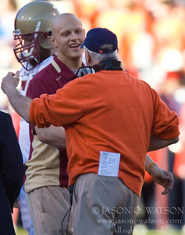 November 14, 2009; Charlottesville, VA, USA;  Boston College Eagles linebacker Mark Herzlich (94) is welcomed by Virginia Cavaliers head coach Al Groh before the game at Scott Stadium.  Boston College defeated Virginia 14-10.  Mandatory Credit: Jason O. Watson-US PRESSWIRE