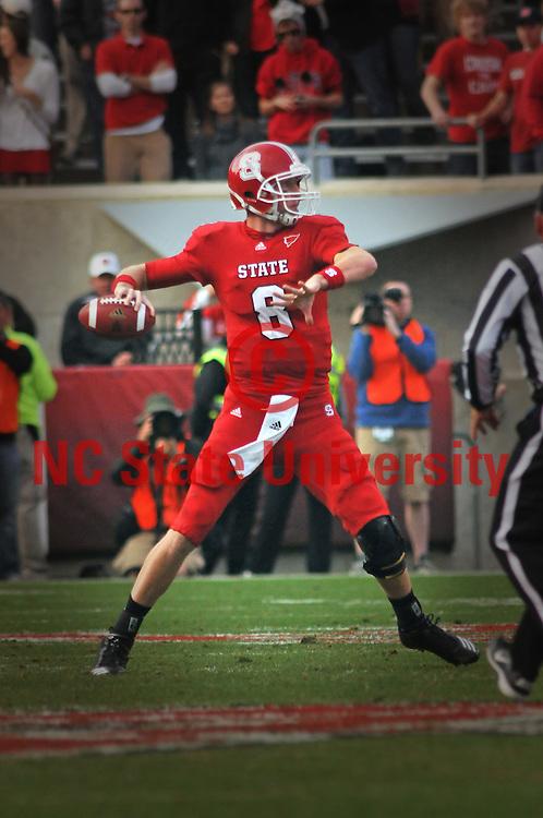 Wolfpack quarterback Mike Glennon looks down field for an open receiver.