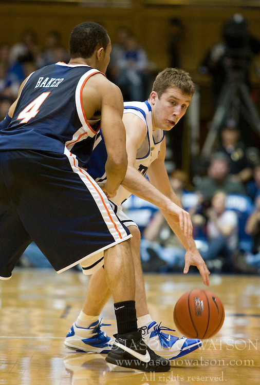 Duke guard Greg Paulus (3) dribbles around Virginia guard Calvin Baker (4).  The Duke Blue Devils defeated the Virginia Cavaliers 87-65 in men's basketball at Cameron Indoor Stadium on the campus of Duke University in Durham, NC on January 13, 2008.