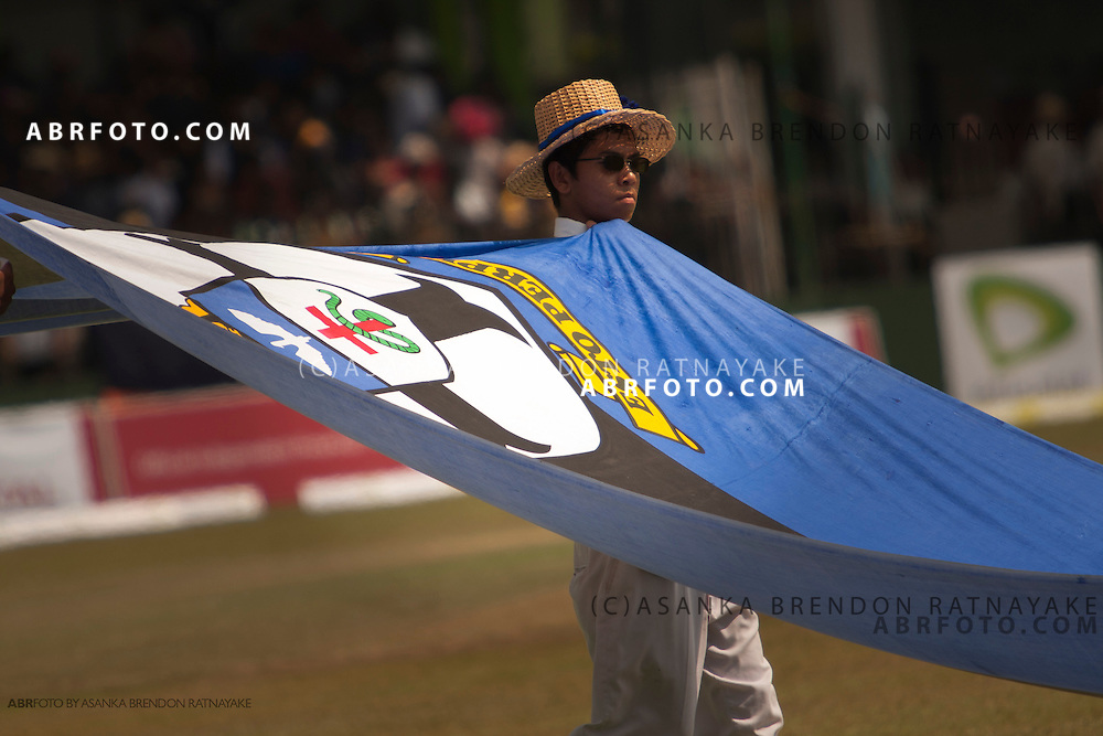 St Thomas student carries large thomian flag.