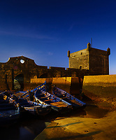 ESSAOUIRA, MOROCCO - CIRCA MAY 2018:  Blue hour over the port of Essaouria and the famous Castelo Real of Mogador.