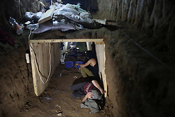 Palestinian workers repair a smuggling tunnel flooded by Egyptian forces beneath the Egyptian-Gaza border in Rafah in the southern Gaza Strip on March 11, 2013. The Gaza Strip s Hamas government accused Egypt last week of flooding cross-border tunnels with sewage water in order to halt a thriving smuggling trade that has helped prop up the local economy for more than five years, March 11, 2013. Photo by Imago / i-Images...UK ONLY.Contact..Andrew Parsons: 00447545 311662..Stephen Lock: 00447860204379.