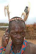 Aari warrior using a mobile phone, Kejafer, Omovalley,Ethiopia,Africa