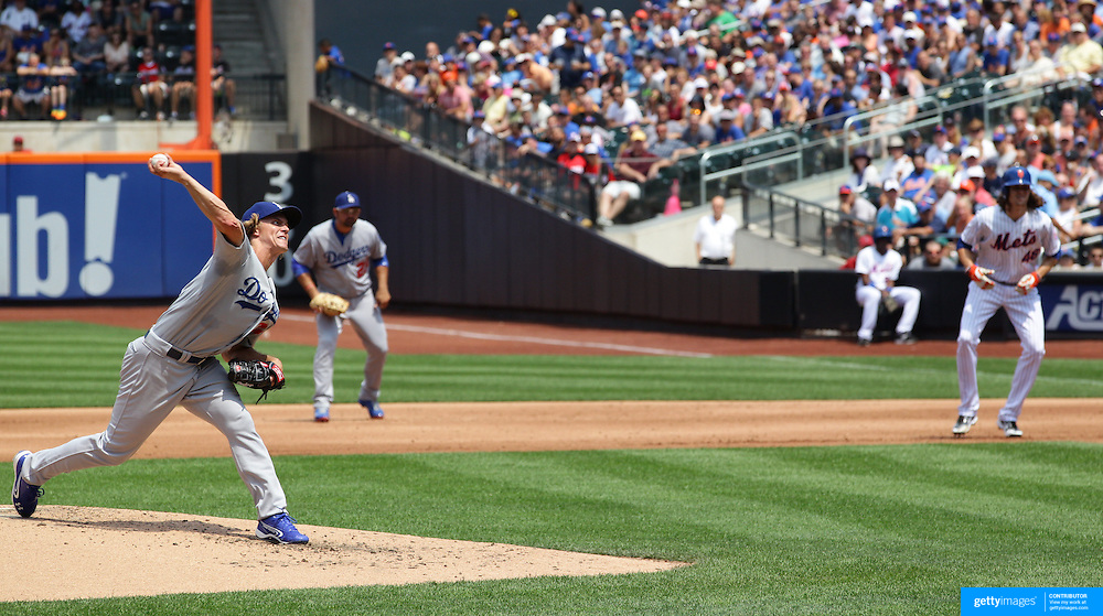 Pitcher Zack Greinke, Los Angeles Dodgers, pitching as Jacob deGrom, New York Mets, watches from first base during the New York Mets Vs Los Angeles Dodgers MLB regular season baseball game at Citi Field, Queens, New York. USA. 26th July 2015. Photo Tim Clayton