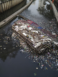 August 9, 2017 - Central Jakarta, Jakarta, Indonesia - Jakarta, Indonesia, 09 August 2017 : Stockpiles of garbe stuck at Ciliwung River Tanah Abang Area-Central Jakarta. Although there has been a lot of campaign in not throwing garbage to Ciliwung River, the awareness from people that living surrounding the river still lack and law enforcement in eradicate such act also still low. Ciliwung River as one of clean water source for people from Bogor-West Java to Jakarta is one of the dirties river in the world with high polute and poisonous. (Credit Image: ©  via ZUMA Wire)