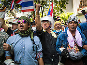04 DECEMBER 2013 - BANGKOK, THAILAND:  Anti-government protestors gather on Rama I Road in front of police headquarters in Bangkok. Several hundred anti-government protestors tried to occupy Royal Thai Police Headquarters on Rama I Road in central Bangkok Wednesday. The protest was one of the continuing protests against the government of Prime Minister Yingluck Shinawatra. Police commanders allowed protestors to tear down police barricades and ordered riot police to lay down their shields. Protestors then chanted anti-government slogans and called on police to turn against the government before forming a motorcade and leaving the area. Anti-government protests have gripped Bangkok for nearly a month and protestors vow to continue their actions. Protests Wednesday were much smaller and more peaceful than protests earlier in the week.     PHOTO BY JACK KURTZ