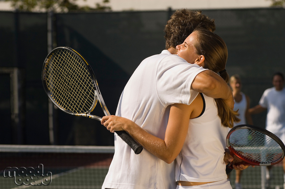 Tennis Players Hugging at Net
