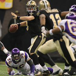 Jan 24, 2010; New Orleans, LA, USA; New Orleans Saints quarterback Drew Brees (9) is pressured by Minnesota Vikings defensive end Brian Robison (96)during a 31-28 overtime victory by the New Orleans Saints over the Minnesota Vikings in the 2010 NFC Championship game at the Louisiana Superdome. Mandatory Credit: Derick E. Hingle-US PRESSWIRE