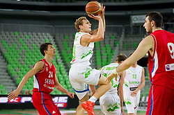 Vladimir Lucic of Serbia vs Jaka Blazic of Slovenia during basketball match between National teams of Slovenia and Serbia in day 3 of Adecco cup, on August 5, 2012 in Arena Stozice, Ljubljana, Slovenia. (Photo by Vid Ponikvar / Sportida.com)