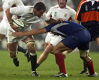 Photo: Richard Lane.<br />France v England. Semi-Final, at the Telstra Stadium, Sydney. RWC 2003. 16/11/2003. <br />England captain, Martin Johnson powers past Raphael Ibanez.