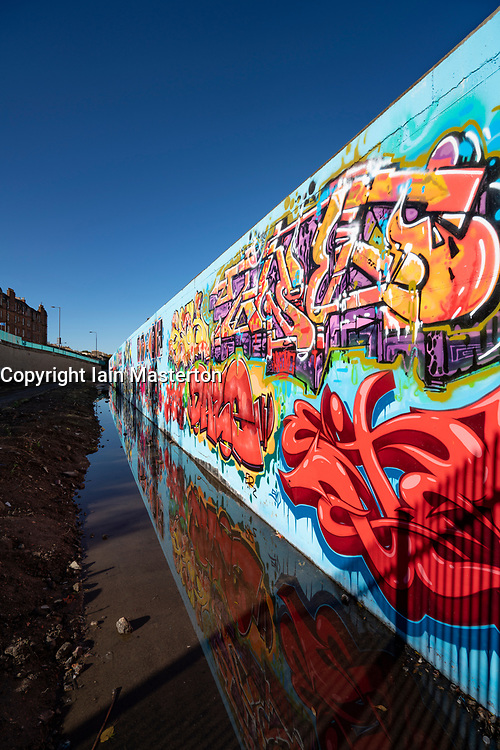View of murals painted on wall at Marine Parade Graffiti Wall in Leith , Scotland,