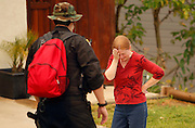 May 15, 2014 - Escondido, California, U.S -<br /> <br /> California Wildfires 2014 - Cocos Fire<br /> <br />  Escondido Police officer NICK RODELO  talks to a distraught resident as police tell people to evacuate due to fire on Johnston Road in Escondido on Thursday.<br /> ©Exclusivepix