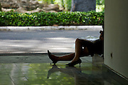 A young lady having a break in a shady corner of the Reunification Palace, former South Vietnamese Presidential Palace.