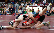 West Delaware's Matt Marbach (right), 16,  works against Williamsburg's Dustin Moran during his first match at North-Linn Community School at 3033 Lynx Drive in Troy Mills on Saturday morning, December 18, 2010. Marbach lost in a major decision 16-5.