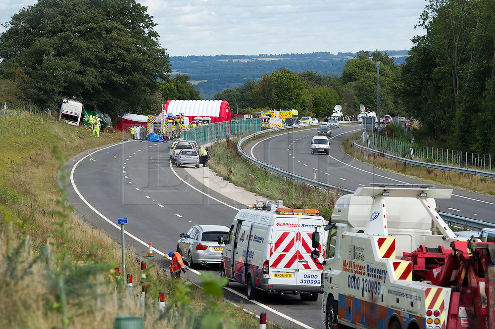 © London News Pictures. 11/09/2012. Hindhead, UK . General view of scene of a fatal bus crash on the north bound A3 motorway near Hindhead Tunnel, Hindhead, Surrey on September 11, 2012.Three people were killed and a number of others seriously injured when a coach carrying overturned after crashing into a tree. Photo credit: Ben Cawthra/LNP