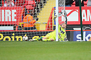 Birmingham City goalkeeper, Tomasz Kuszczak (29) was not able to stop Charlton Athletic defender, Jorge Teixeira (50) from scoring during the Sky Bet Championship match between Charlton Athletic and Birmingham City at The Valley, London, England on 2 April 2016. Photo by Matthew Redman.