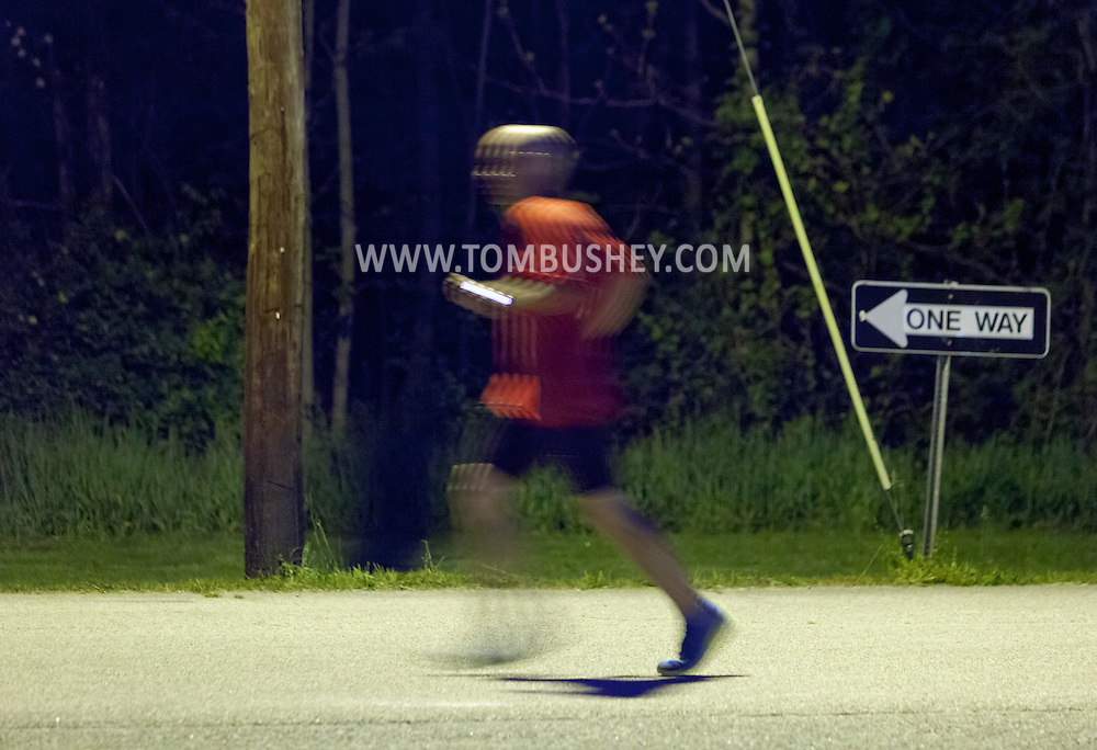 Augusta, New Jersey - A runner on the course at night during the 12-hour race during the 3 Days at the Fair races at Sussex County Fairgrounds on May 11, 2012.