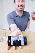 European Geosciences UnionGeneral Assembly 2012 at Austria Center Vienna..Professor Michael E. Mann, U.S.American climatologist, showing a souvenir photo of himself with former U.S. President Bill Clinton on his iPhone during an interview with Ingo Arzt, taz/Berlin.