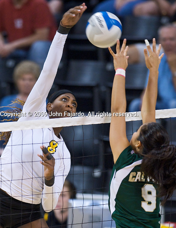Naomi Washington(8) attacks the block of Chelsea Hardin(9) in the Big West Conference game against Cal Poly at the Walter Pyramid, Long Beach CA, Saturday Oct. 3, 2009.