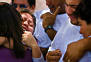 Maribel and Jesús grieve during their daughter's funeral. Their parents played an important role in helping them through Sinaí's difficulties, nurturing their hope for her improvement while stressing the importance of their faith. (Xavier Mascareñas)